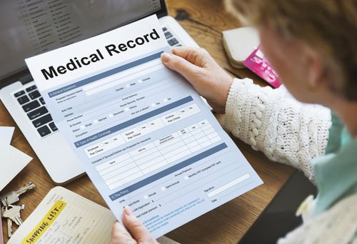 Should I release my medical records to another driver's insurance adjuster?