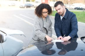 Two drivers settling insurance claims.